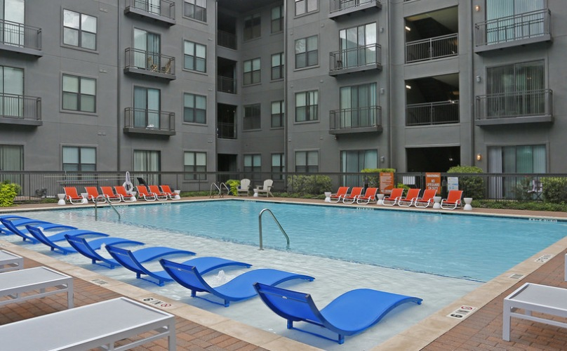 Large pool with poolside lounge chairs